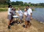 Honors biology students from Fontbonne Hall Academy collecting water samples