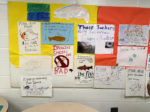 A bulletin board of student-made signs regarding invasive species